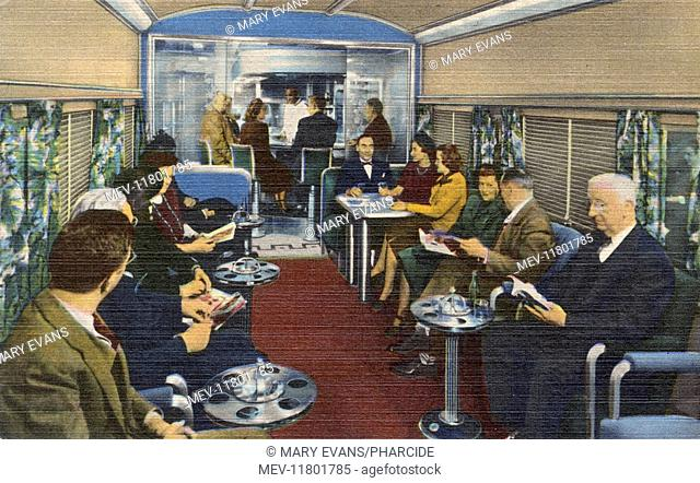 Passengers relaxing in a carriage of the Coffee Shop Club on the new Wabash Blue Bird streamliner train, operating between St Louis and Chicago, USA