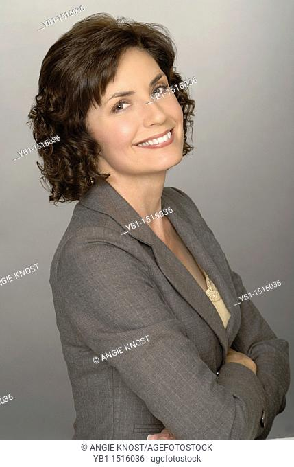 Attractive business woman portrait, smiling and looking at camera or viewer