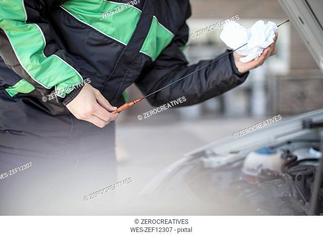 Man checking motor oil