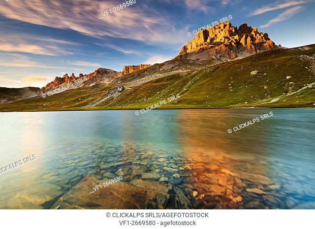 Europe, France, Ubaye - Oronaye Lake and Oronaye peak at sunset