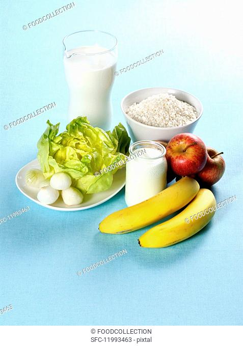 An arrangement of fruit, vegetables and dairy products