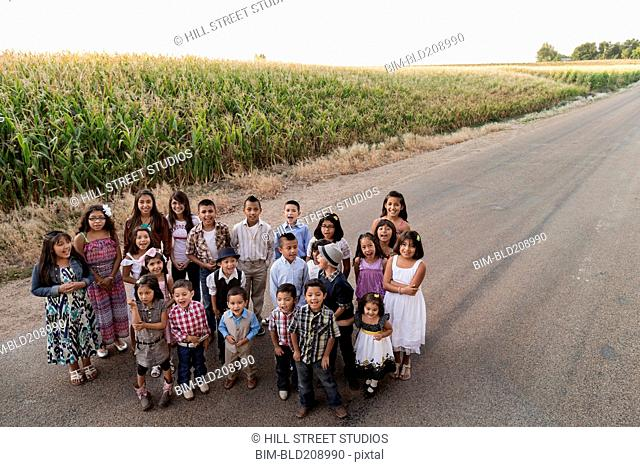 Family smiling together on rural road
