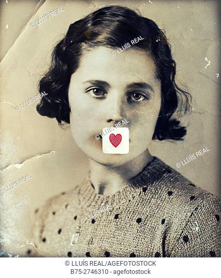 Antique portrait of young woman looking at the camera, with a red heart in her mouth