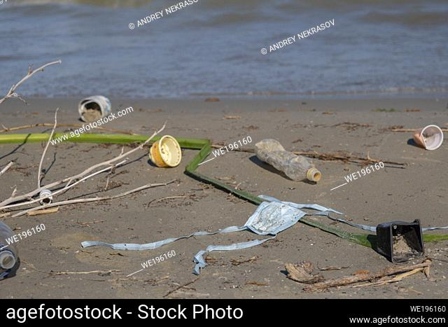 DANUBE DELTA, VYLKOVE, ODESSA OBLAST, UKRAINE - JULY 11-15, 2020: Plastic pollution in Danube Biosphere Reserve. Plastic and other garbage from all over Europe...