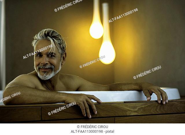 Man soaking in hot tub