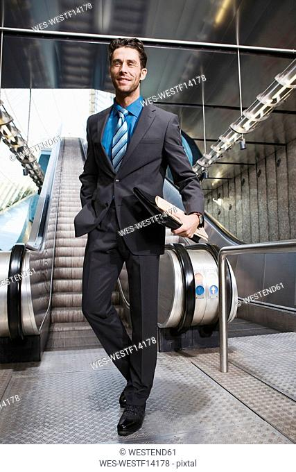 Germany, Bavaria, Munich, Business at subway station, escalator in background