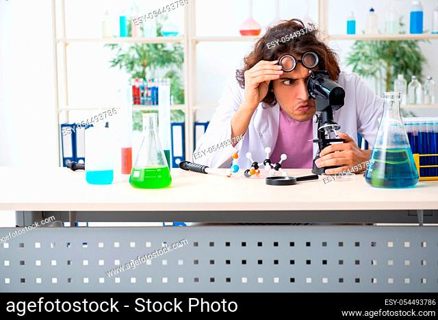 The funny male chemist working in the lab
