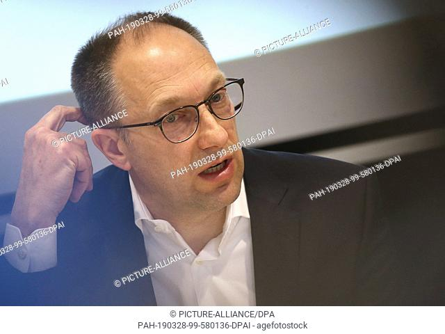 28 March 2019, Bavaria, Augsburg: Peter Mohnen, CEO of Kuka AG, sits at the company's annual press conference for 2018. Photo: Karl-Josef Hildenbrand/dpa