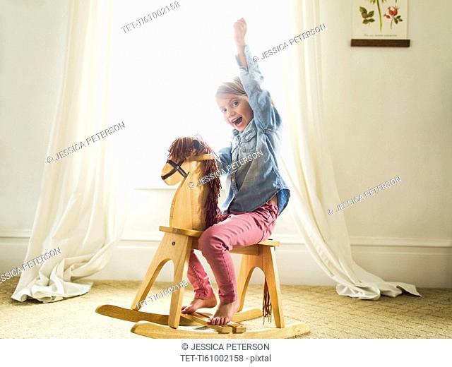 Girl (4-5)on rocking horse