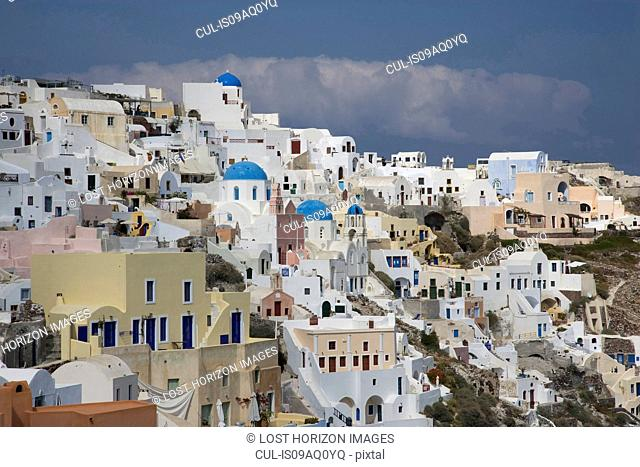View of painted and white washed hillside town, Oia, Santorini, Cyclades, Greece