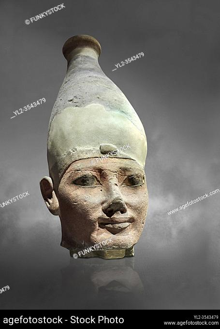 Ancient Egyptian head of a Thutmosid Thutmose king, New Kingdom, 18th Dynasty (1550-1292 BC), Thebes. Egyptian Museum, Turin. Grey background.