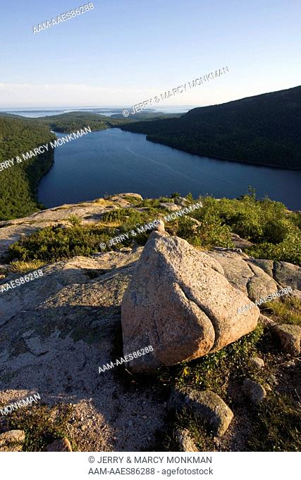 A boulder on the summit of South Bubble Mountain in Maine's Acadia National Park. Jordan Pond is below