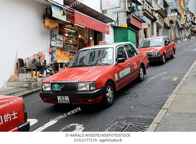 Hong Kong, China, Asia. Hong Kong Soho. Typical Hong Kong taxis in one of Soho's steep streets