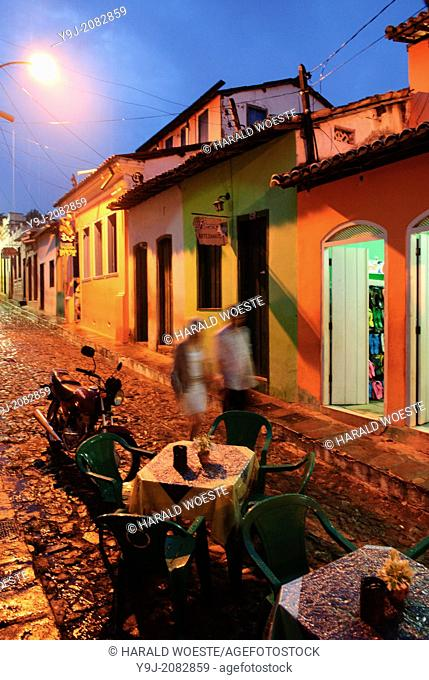 Brazil, Bahia, Lencois (Parque Nacional de Chapada Diamantina): Though hit by a thunder-storm the small shopping streets with all its restaurants and bars in...