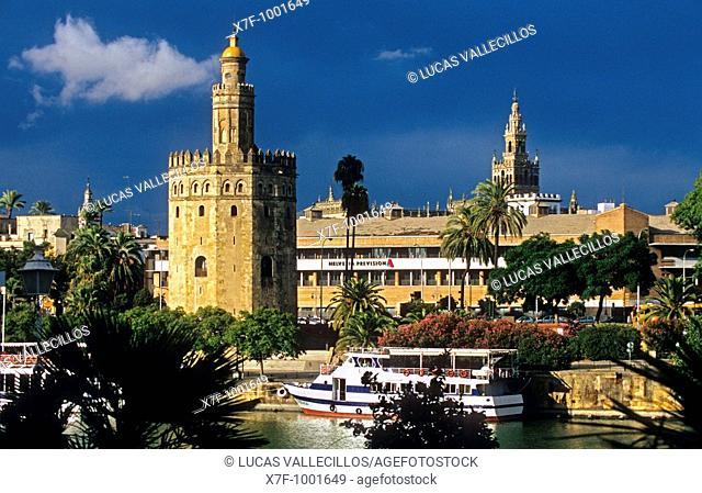 Sevilla: Gold tower and Giralda tower, as seen from Guadalquivir river