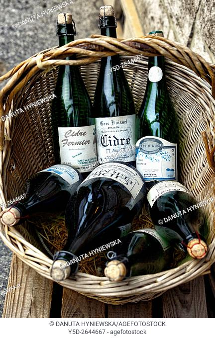 Bottles of cider in basket. Honfleur. Normandy, France