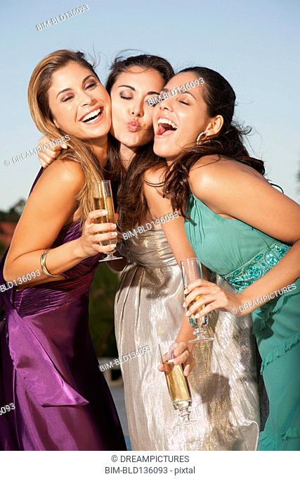 Women posing together at party