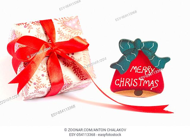 Christmas present and Christmas bell decoration stand on white background