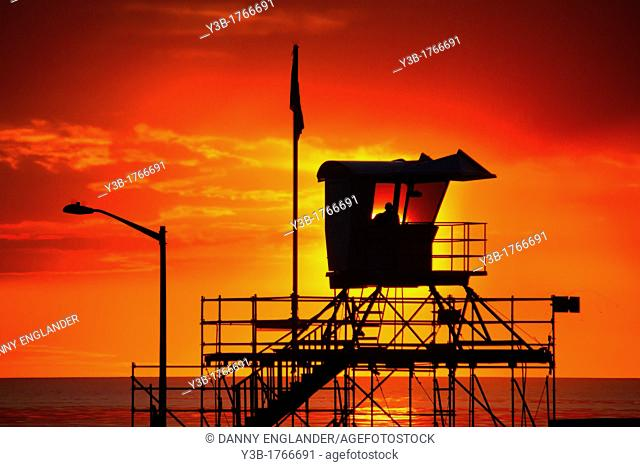 Silhouette of a Lifeguard Tower at Sunset