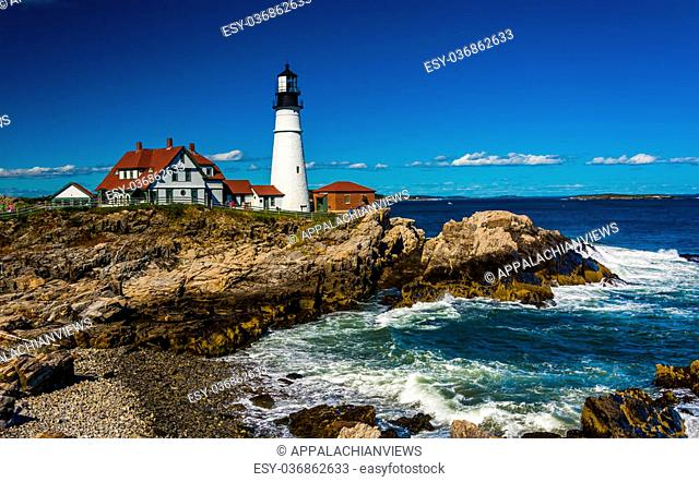Portland Head Lighthouse and the Atlantic Ocean at Fort Williams Park in Cape Elizabeth, Maine