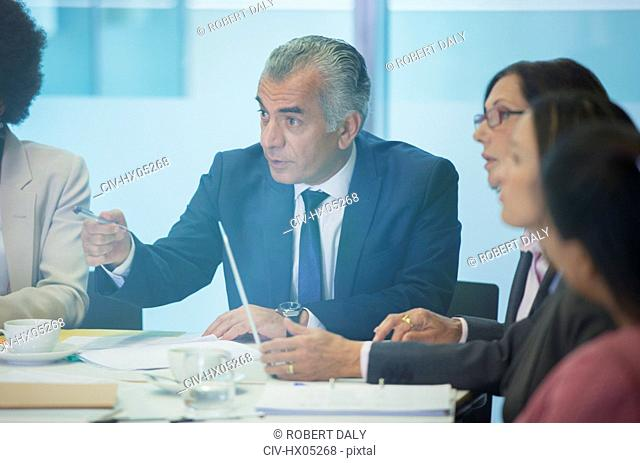 Serious businessman talking in conference room meeting