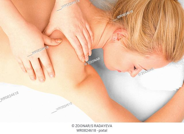 Young blonde woman in SPA