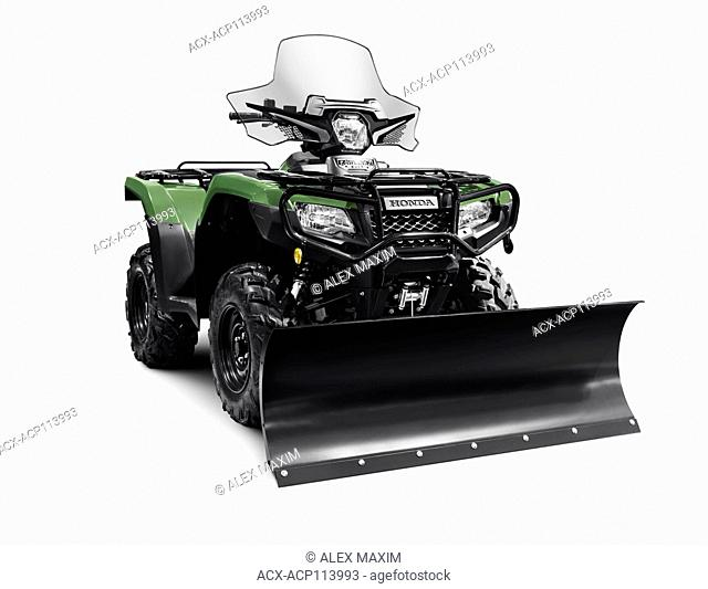 2017 Honda Rubicon Foreman 500 4x4 ATV with snow plow blade isolated on white background with clipping path