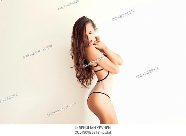 Studio portrait of young woman wearing swimwear