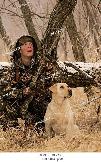 Hunter Ground Hunting With Yellow Lab