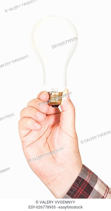 hand holds big incandescent lamp isolated on white background