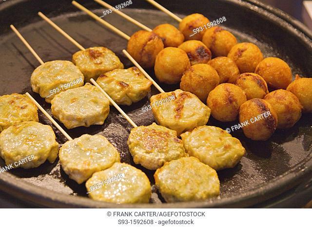 Fried Japanese snacks on sticks in Nishiki market