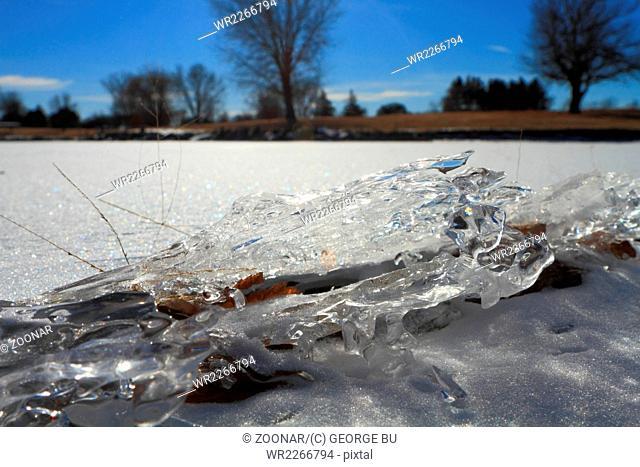 Beautiful ice fragment on frozen lake in winter