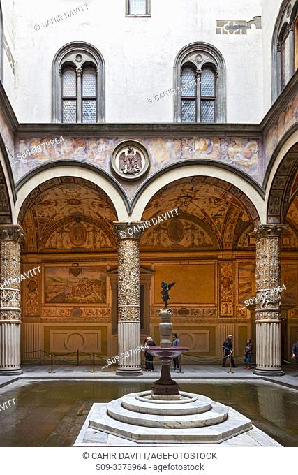"""Architectural detail of the 1st courtyard of the Palazzo Vecchio with designed by the architect Michelozzo with """"""""Putto with Dolphin"""""""" by Verrocchio in the..."""
