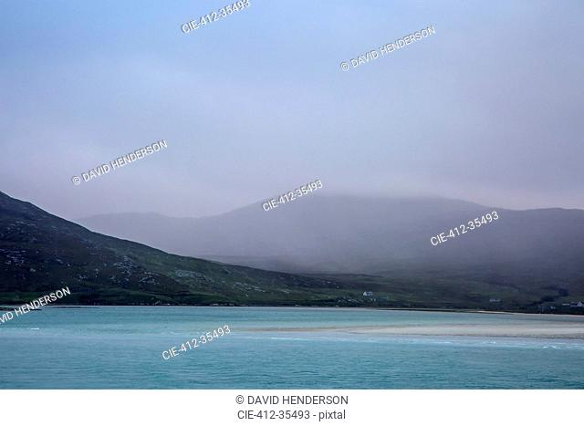 Fog rolling over tranquil mountains and ocean, Golden Road, Harris, Outer Hebrides