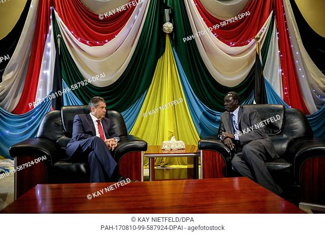 German Foreign Minister Sigmar Gabriel being received at the International Airport of Juba by his South Sudanese counterpart, Deng Alor Kuol (R), in Juba