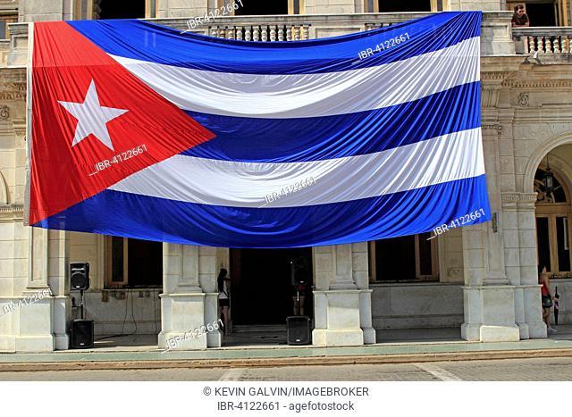 Large Cuban flag, hangs from building, Santa Clara, Cuba