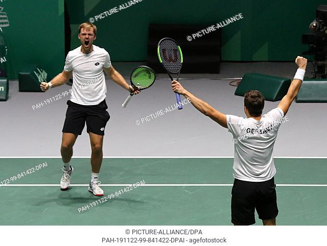 20 November 2019, Spain, Madrid: The tennis players form Germany's doubles team celebrates their victory against Argentina, to finish the serie 3-0