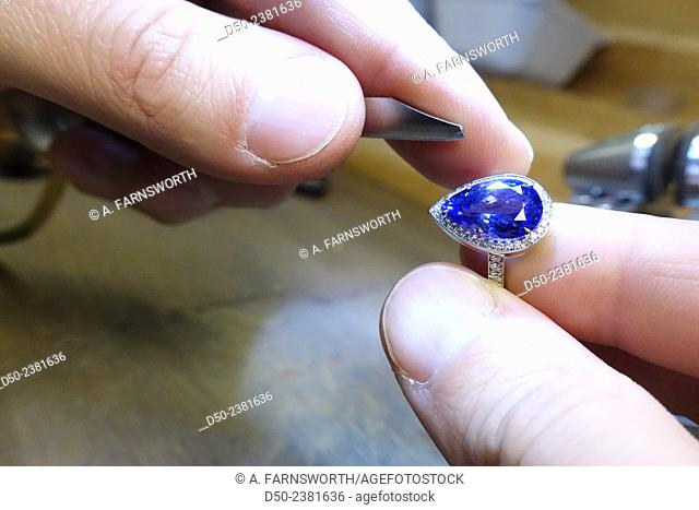 Jeweler working on a saphire for a wedding ring, Stockholm, Sweden