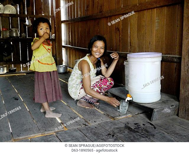 CAMBODIA. Projects of DPA in Stung Treng, supported by SCIAF. Ban Bung village. Case study of Ms Ton Nai 30 who has 5 children  She is beneficiary of a DPA well...