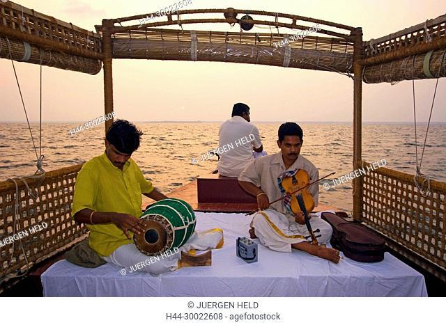 India Kerala house boat in backwater lake indina musicians at sunset tour