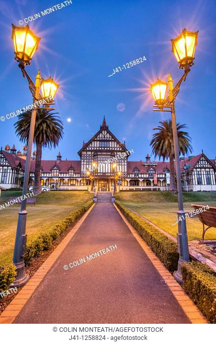Rotorua Museum entrance pathway lined by lamps at dusk, Government gardens, Rotorua