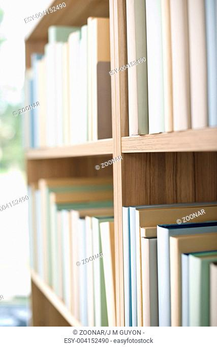 Library - row of books on bookshelf