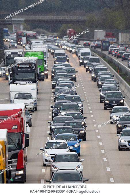 12 April 2019, Lower Saxony, Wedemark: Cars and trucks are stuck in traffic jams on the federal highway 7 heading north. Eight federal states will start the...