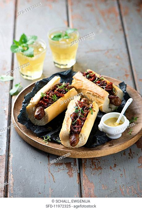 Hot dogs with caramelised onions and mastered