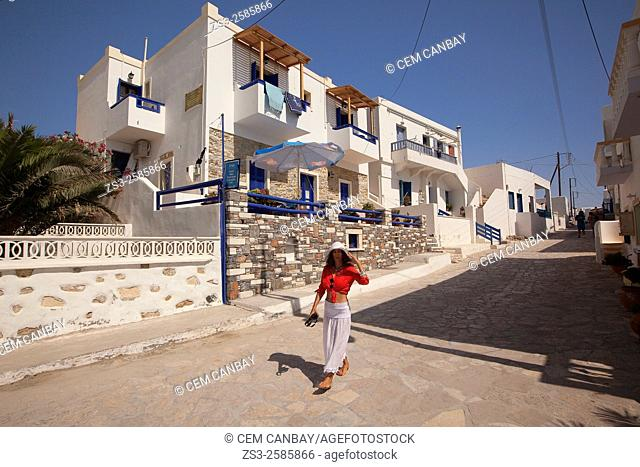 Woman walking in the town center in front of typical cyclades houses, Koufonissi, Cyclades Islands, Greek Islands, Greece, Europe