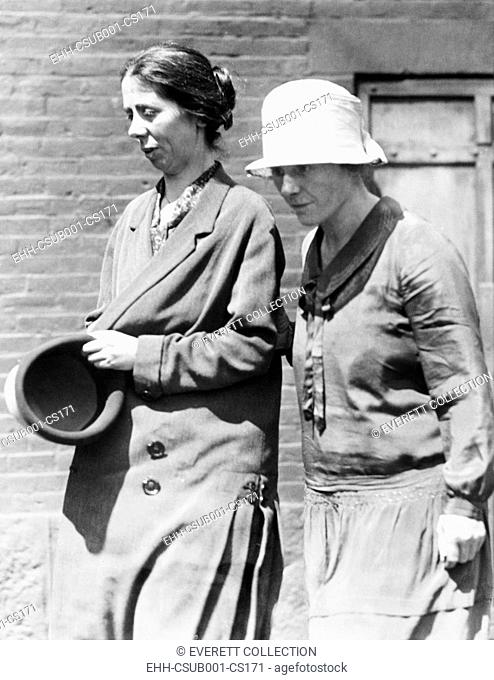 Miss Luigia Vanzetti, (left) is shown leaving the Charlestown State prison with Mrs. Nicola Sacco. Miss Vanzetti is visiting her brother