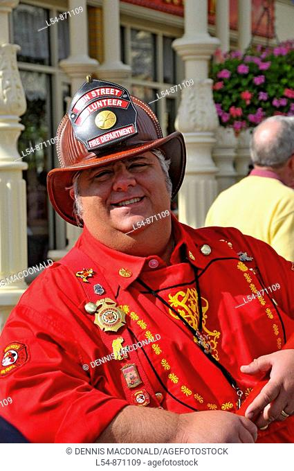 Firefighter in red shirt at Walt Disney Magic Kingdom Theme Park Orlando Florida Central