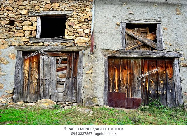 Rustic doors of Aoslos, Madrid, Spain