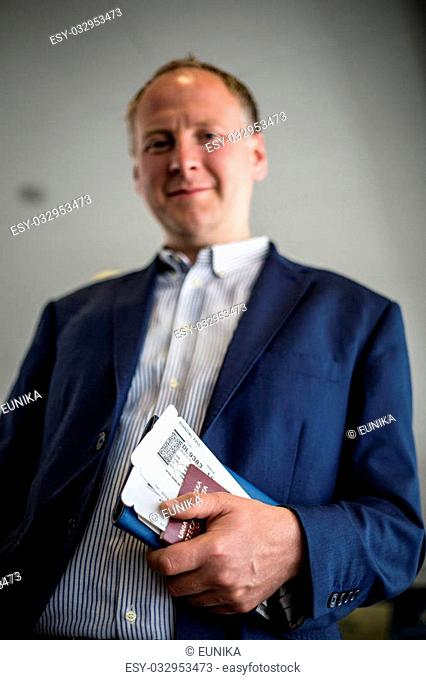 Man with boarding pass and passport at the airport