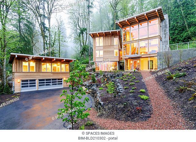 Modern house illuminated in woods